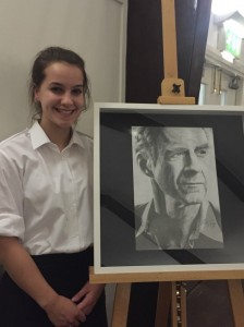 Phoebe Hessien with her pencil drawing of Sir Ranulph which was sold during the silent auction